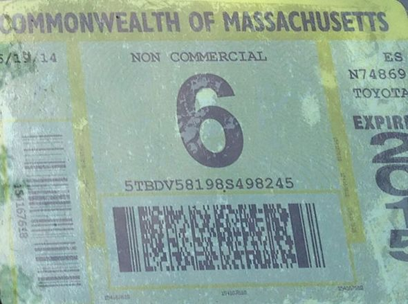 A Vehicle Inspection Sticker is stuck to a car on Jan. 31